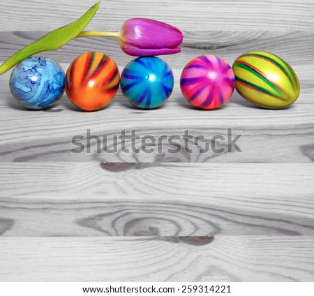 Colorful Easter eggs isolated on wooden background. - stock photo