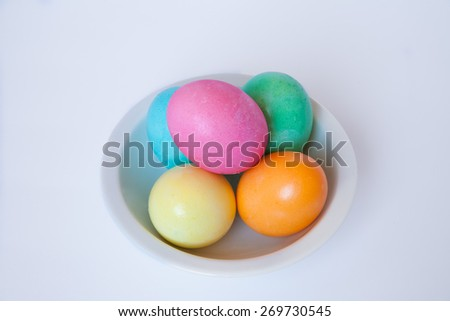 Colorful Easter eggs on a white plate
