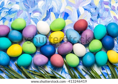 Colorful Easter eggs on bright background. Easter holiday. Multicolored background green, blue and purple colors. - stock photo