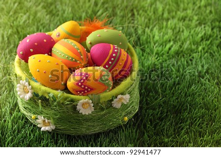 Colorful easter eggs  on green grass - stock photo