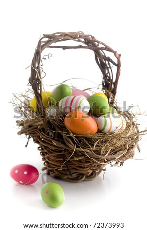 Colorful easter eggs on green grass, isolated on white - stock photo