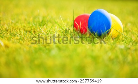 Colorful easter eggs on green meadow - stock photo