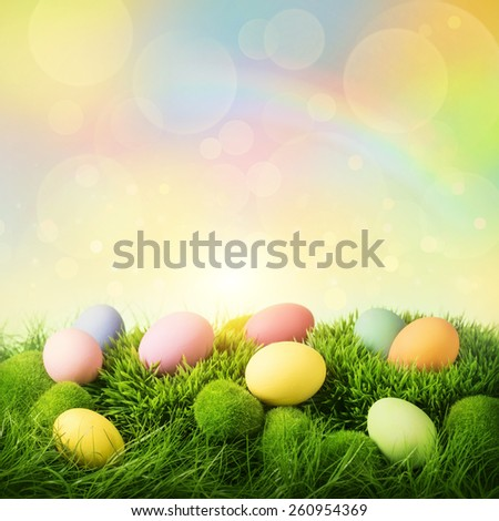 Colorful easter eggs on pastel colored background - stock photo