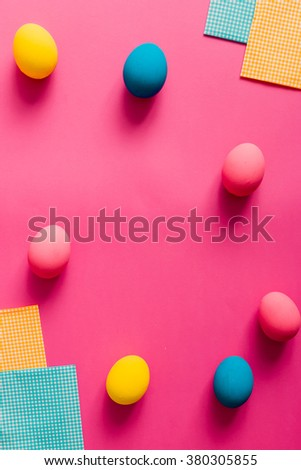 Colorful Easter eggs on pink paper - stock photo