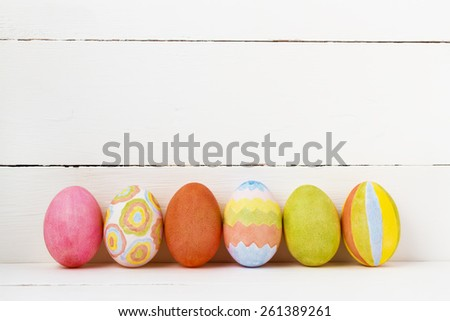 Colorful Easter eggs on white background with copy space - stock photo