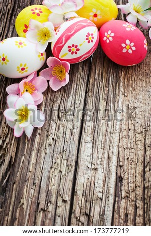 Colorful Easter eggs on wooden background/ Easter holidays background - stock photo