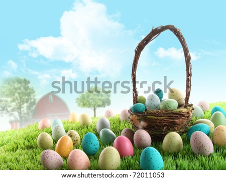 Colorful easter eggs with basket in field of grass with blue sky - stock photo