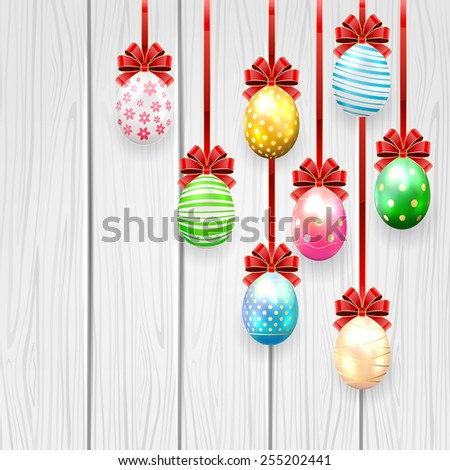 Colorful Easter eggs with red bow on wooden background, illustration. - stock photo