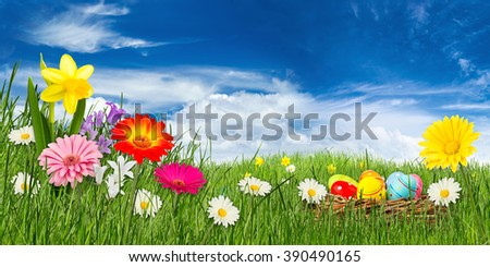 colorful easter meadow in front of blue sky - stock photo