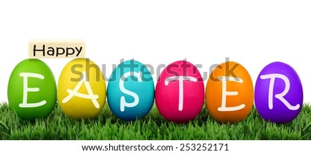 Colorful eggs on grass with Happy Easter text over white