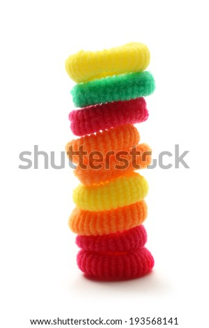 Colorful elastic hair bands on white background - stock photo