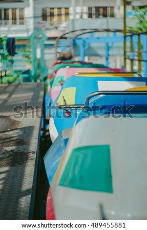 Colorful electric bumper car in the fairground attractions at amusement park.