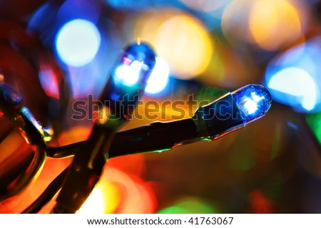Colorful electric light bulbs and lights out of focus