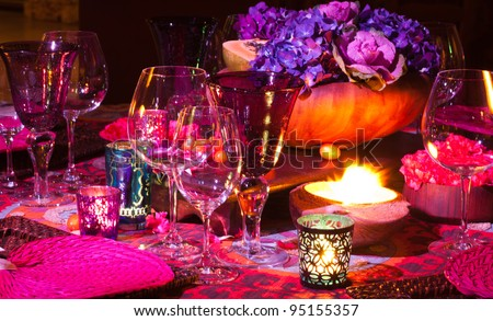 Colorful elegant dinner table setting. - stock photo