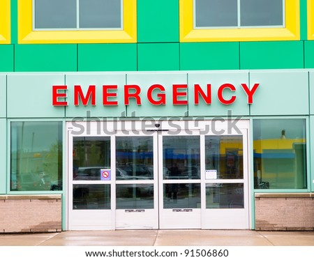 Colorful Emergency Entry/Exit door implying this is image of children's hospital. - stock photo