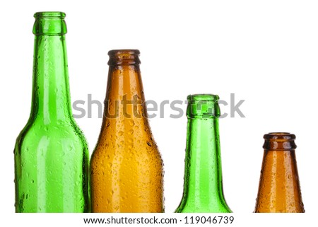 Colorful empty glass bottles isolated on white
