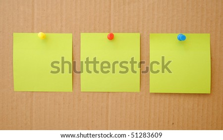 colorful empty notes over brown cardboard