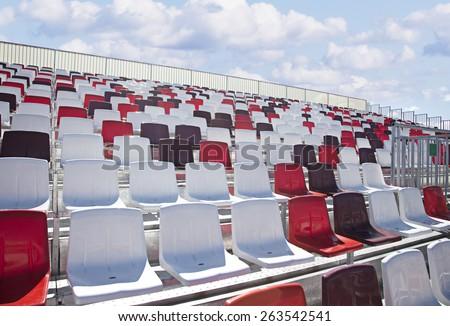 Colorful empty plastic seats on new modern concrete stadium tribune. Moscow Raceway, Formula 1 Racing Tribune, Moscow, Russia. - stock photo