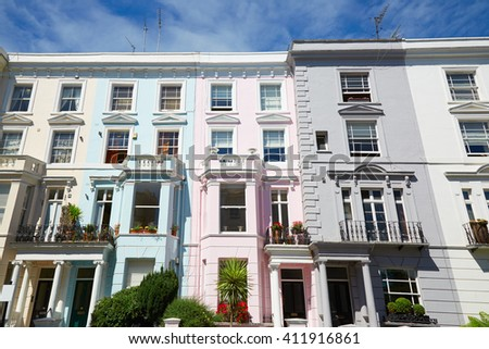 Colorful English houses facades in London, blue sky in a sunny day - stock photo