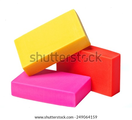 colorful erasers on a white background - stock photo