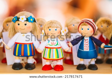 Colorful Estonian Wooden Dolls At The Market. Dolls Are The Most Popular Souvenirs From Tallinn And Symbol Of Country's Culture. - stock photo