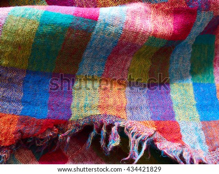Colorful ethnic hand woven fabric material cloth on display in a market - stock photo