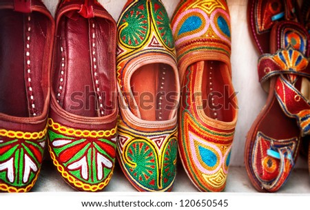 Colorful ethnic shoes on flea market in India - stock photo