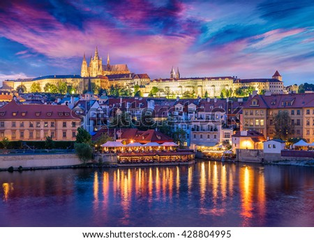Colorful evening view from Charles Bridge of Prague Castle and St. Vitus cathedral on Vltava river. Dramatic spring sunset in Prague, Czech Republic, Europe. Artistic style post processed photo.
