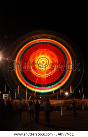Colorful Eye as part of the midway at the 2009 Douglas County Fair in Roseburg Oregon at night. - stock photo