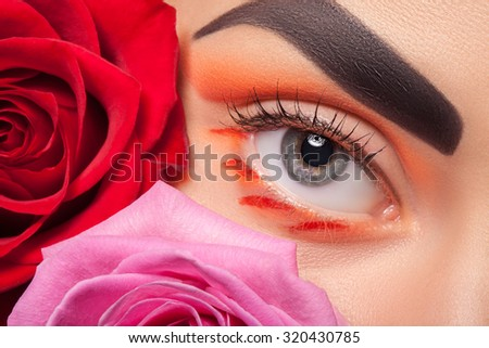 Colorful eye makeup on the background color. A good idea for the advertising of cosmetics.