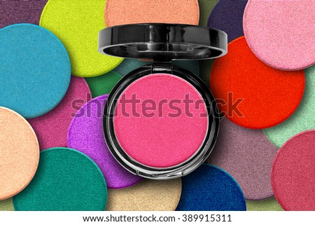 colorful eye shadows background with product - stock photo