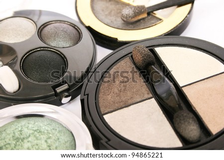 Colorful eye shadows closeup picture.