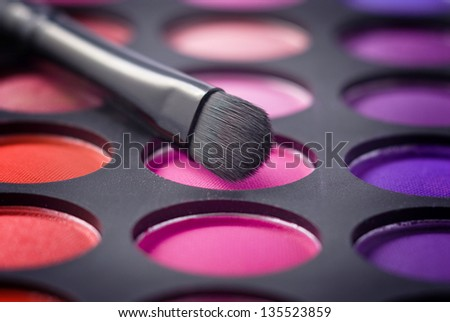 Colorful eye shadows palette with makeup brush. - stock photo