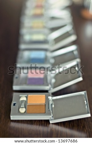 Colorful eyeshadow on the table - stock photo