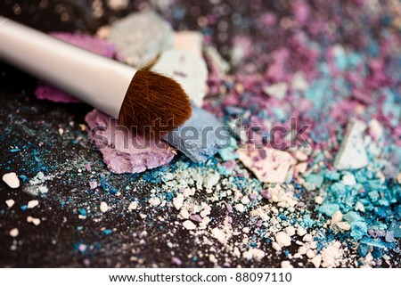 colorful eyeshadow powders and make-up brush - stock photo
