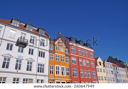 Colorful fa�§ades of old townhouses along Nyhavn Harbour in the center of Copenhagen - stock photo