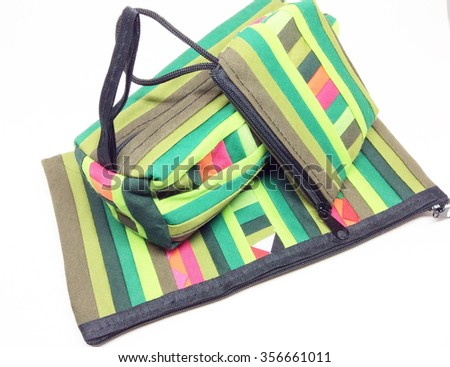 Colorful fabric bag with zipper on white background