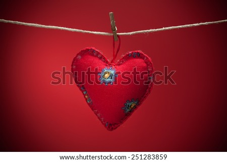 Colorful fabric hearts on red backgrounds. Valentine's Love concept - stock photo