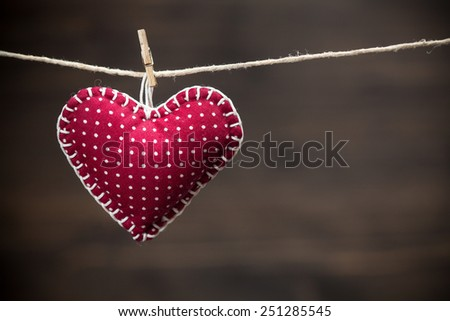 Colorful fabric hearts on wood backgrounds. Valentine's Love concept - stock photo