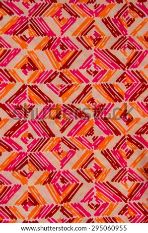Colorful fabric pattern close up background. - stock photo