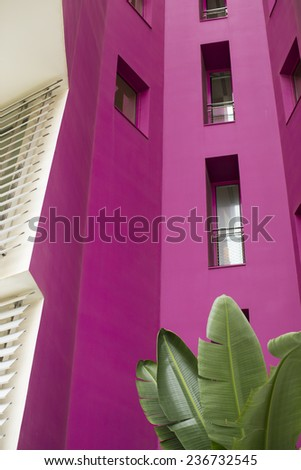 Colorful facade of a modern house with plants - stock photo