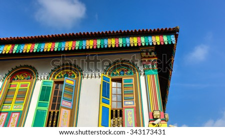 Colorful facade of building with clear blue sky in Little India, Singapore. Little India is an ethnic neighborhood in Singapore that has Tamil cultural elements and aspects. Colorful urban concept