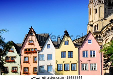 Colorful facade of houses at St. Martin's church in Cologne, Germany - stock photo