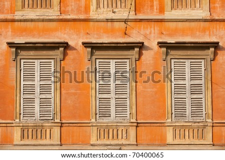 Colorful facade of old Modena building, Italy - stock photo
