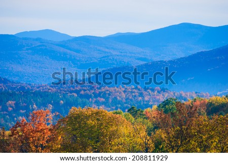Colorful fall foliage mountain range, Stowe Vermont, USA - stock photo