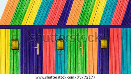 colorful fantasy house made with wooden sticks with wrought iron lamp on a white background