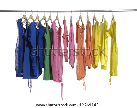 Colorful fashion clothing hanging on hangers - stock photo