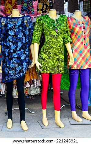 Colorful fashion dress on female mannequins - stock photo