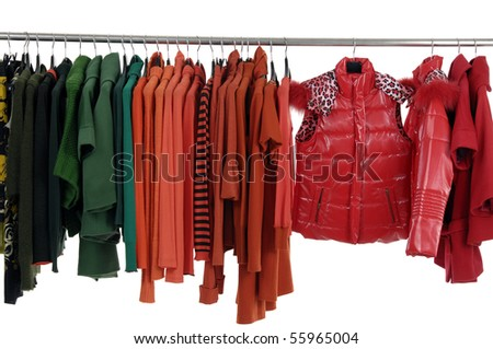 Colorful female coat on hangers at the show - stock photo
