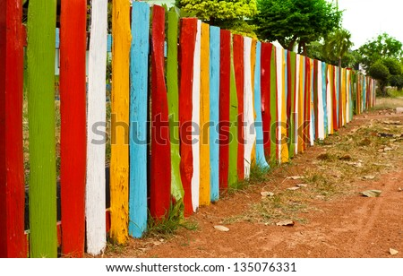 colorful fence,many colors of the wood - stock photo